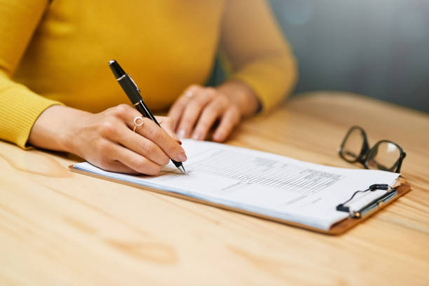 paying attention to some paperwork - form document stock pictures, royalty-free photos & images