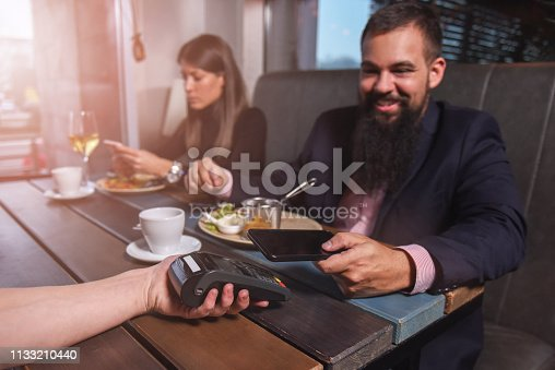 Paying bills at the restaurant by smart phone