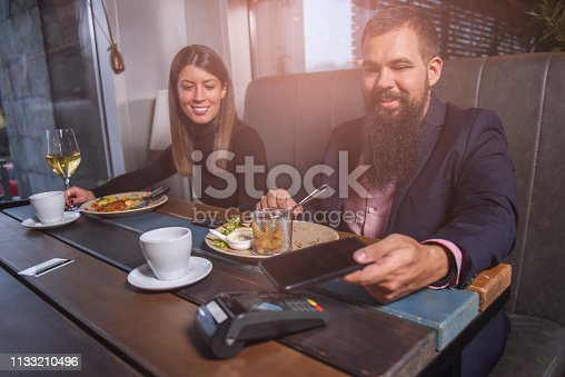 istock Paying bills at the restaurant by smart phone 1133210496