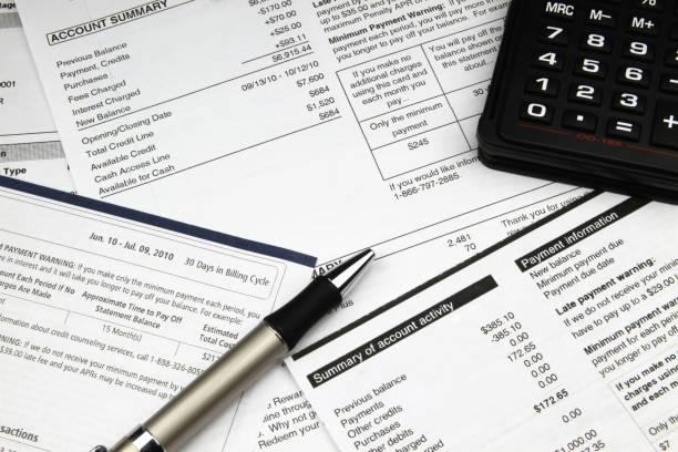 paying bills - estratto conto bancario foto e immagini stock