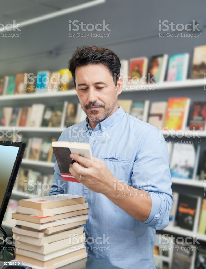 Paying books at a book store stock photo