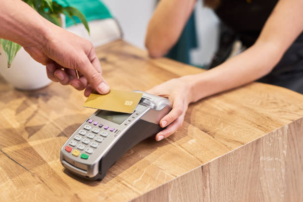 Paying by credit card in hair salon stock photo