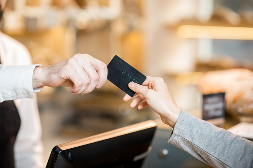 Paying By Credit Card In The Store With Bakery Products Stock Photo - Download Image Now