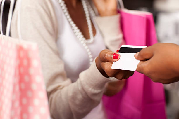 paying by credit card. - gift voucher or card stock photos and pictures