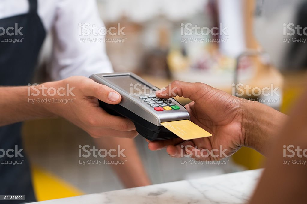 Paying by credit card reader stock photo