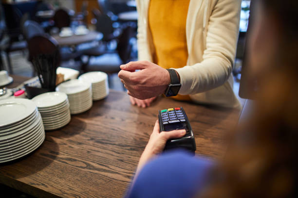 Paying by smartwatch stock photo