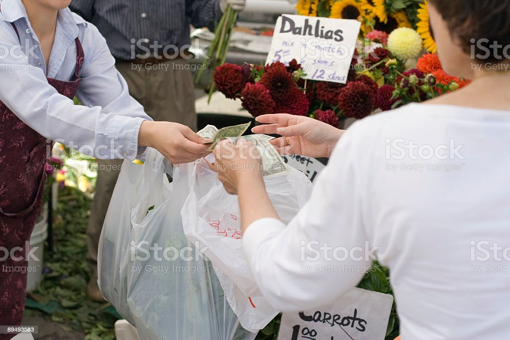 Paying cash for fresh produce at farmers market royalty-free stock photo