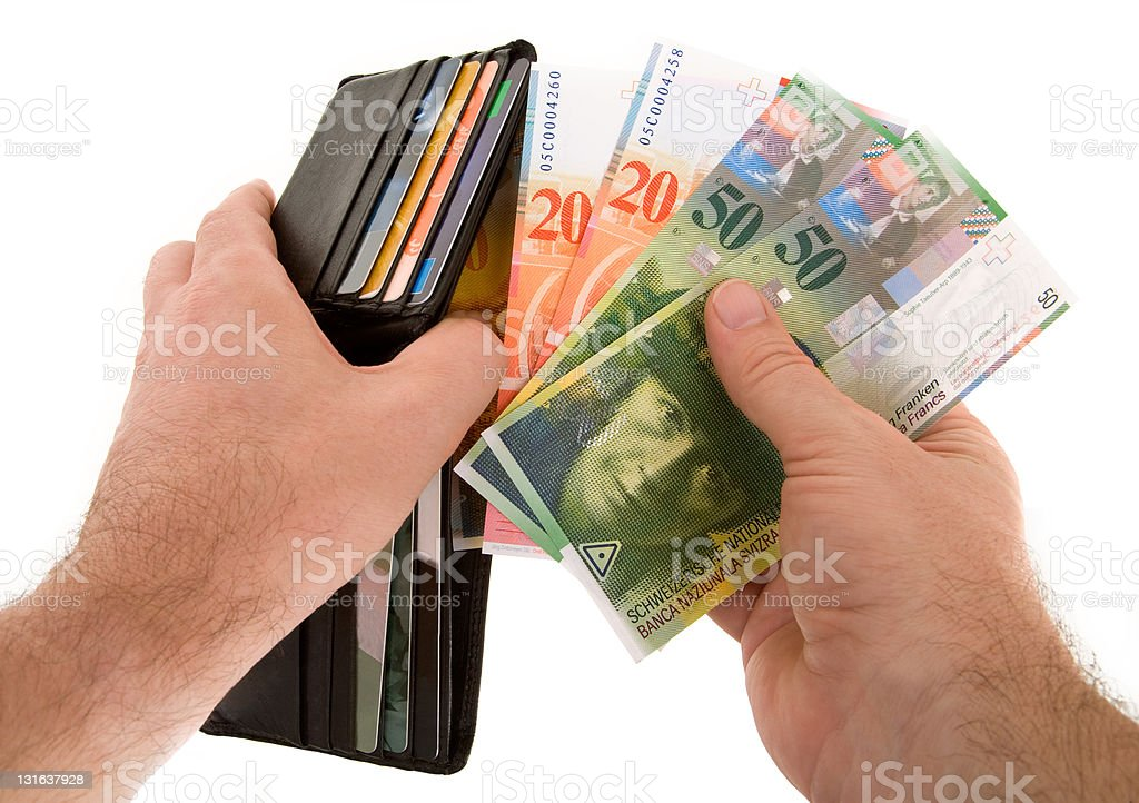 Paying Cash with Swiss Francs Currency royalty-free stock photo