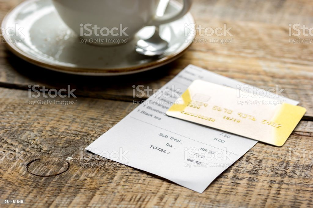 paying check for lunch with card wooden table background stock photo
