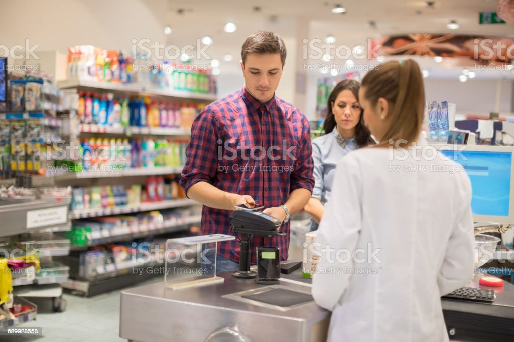 Paying contactless in supermarket stock photo