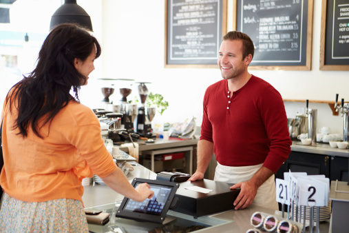 Paying customer with touchscreen monitor
