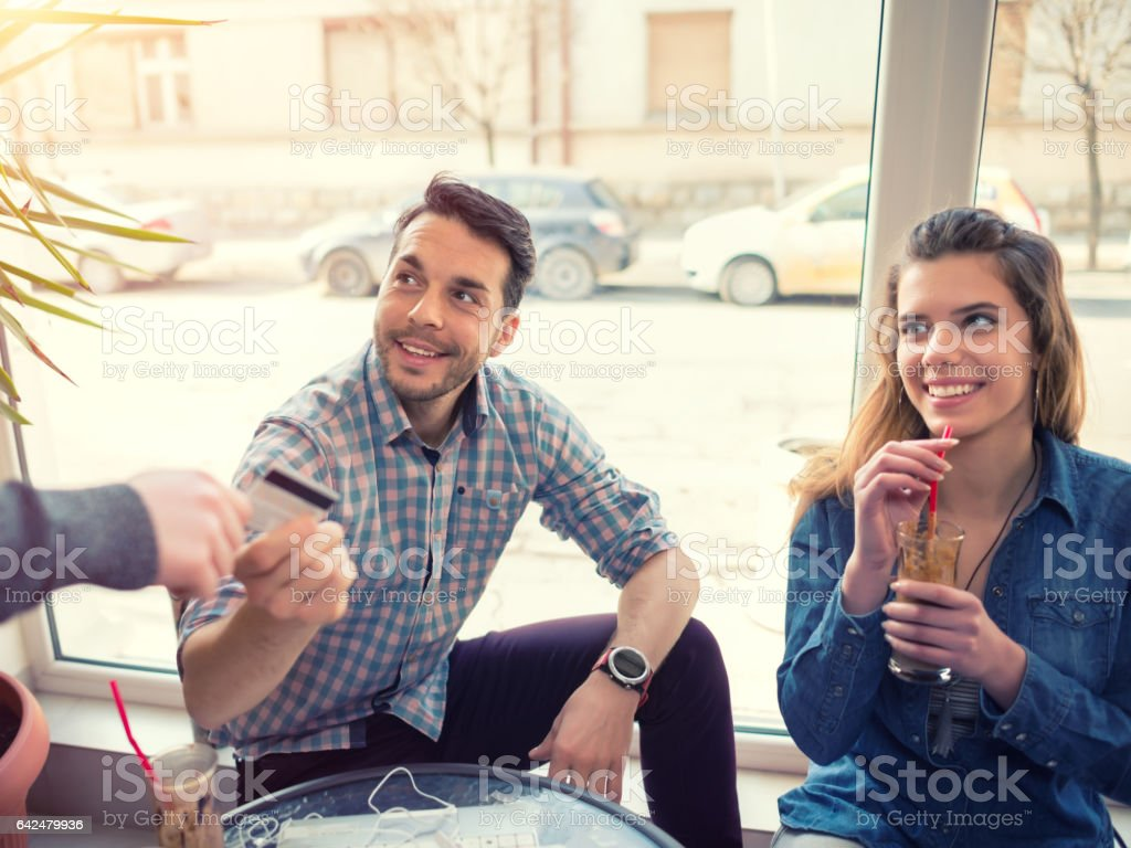 Paying for coffee stock photo