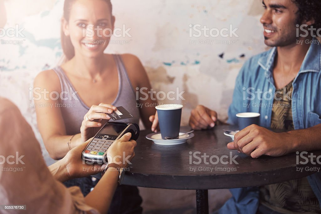Paying for coffee quickly and conveniently stock photo