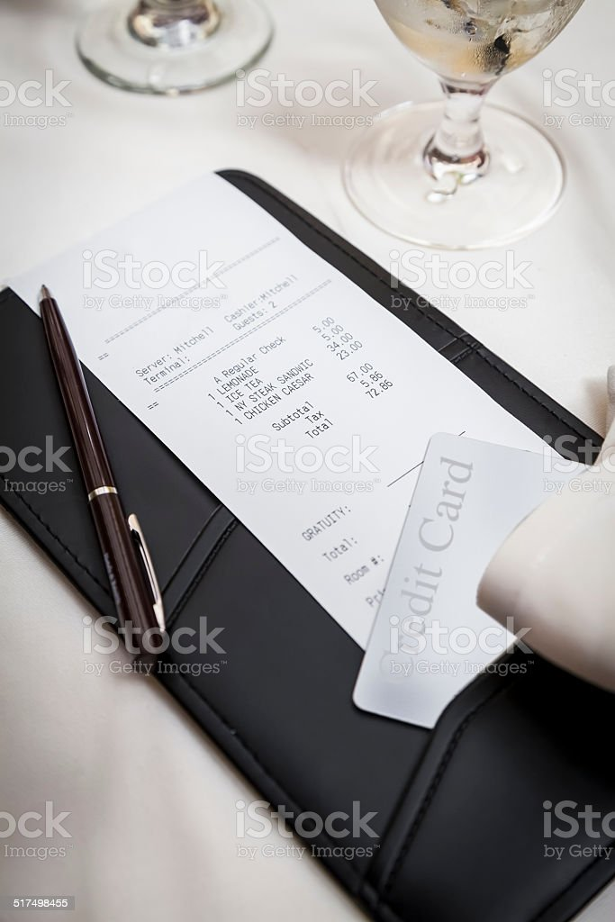Paying for dinner stock photo
