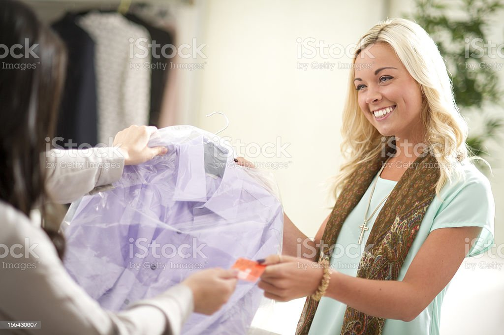 paying for dry cleaning stock photo