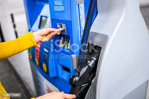Making a payment for gas at a fuel station.