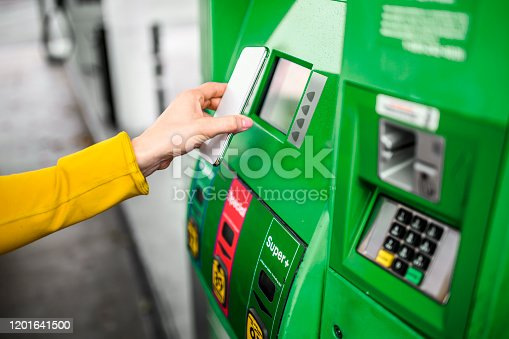 Making a payment for gas on a station.
