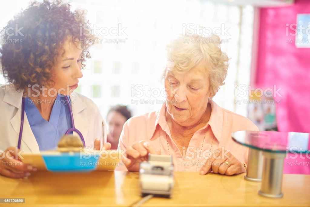 Paying for her treatment stock photo