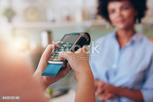 istock Paying for juice by credit card reader 542015140
