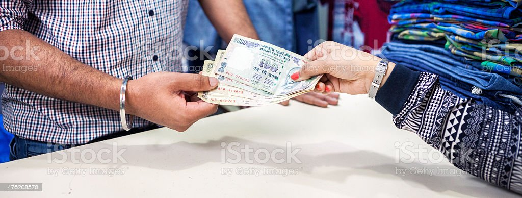 Paying For Something at a Clothing Store - Indian Rupees stock photo