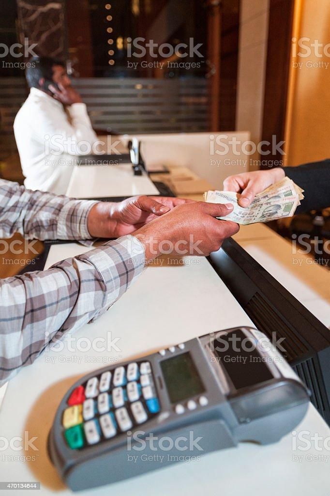 Paying For Something - Indian Rupees stock photo