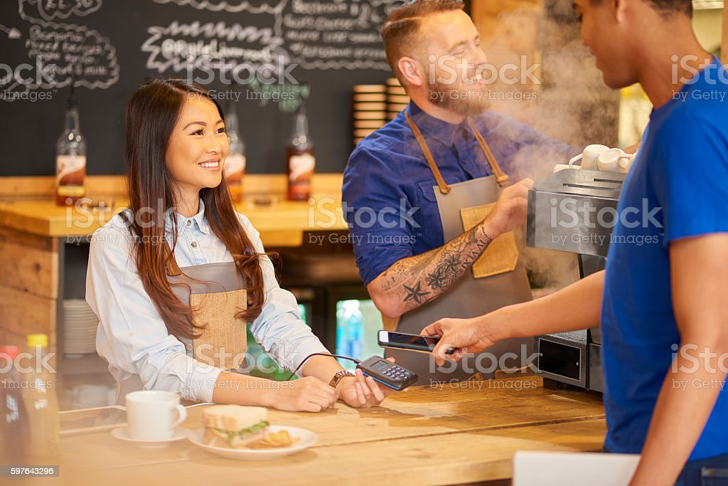 paying in the coffee shop stock photo
