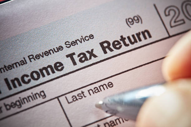 gelir vergisi ödeme - vergi stok fotoğraflar ve resimler