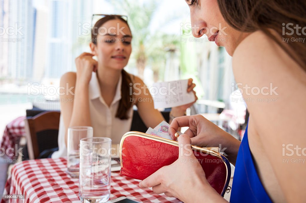 Paying the check at the restaurant stock photo