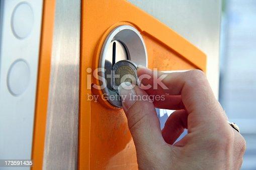 Inserting a coin in a cash machine