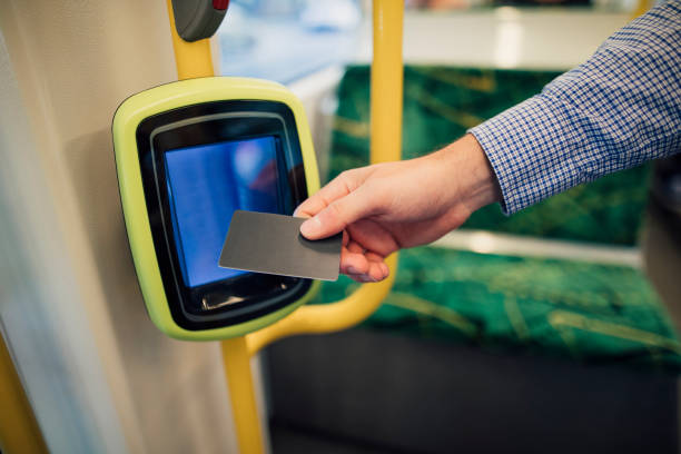 Paying Tram Fare With Contactless Card Close up shot of a commuting businessman scanning his travel card on a tram in Melbourne, Victoria. radio frequency identification stock pictures, royalty-free photos & images