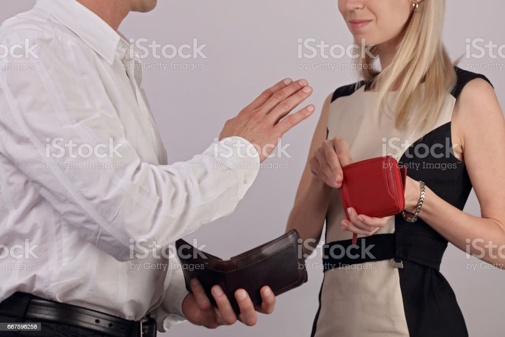 Paying while dating. Man does not allow woman to pay the bill. Dating etiquette stock photo