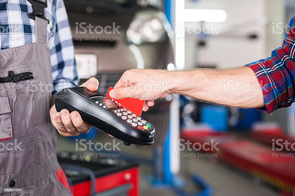 Paying with credit card at car service stock photo