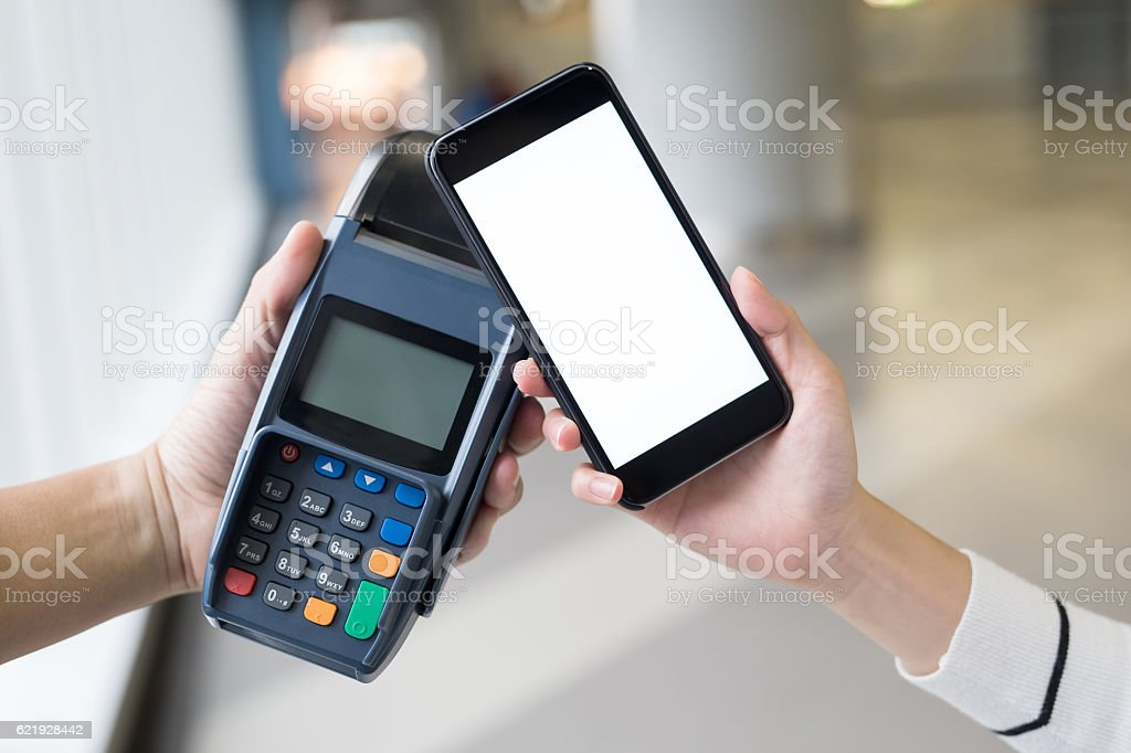 Paying with smartphone stock photo