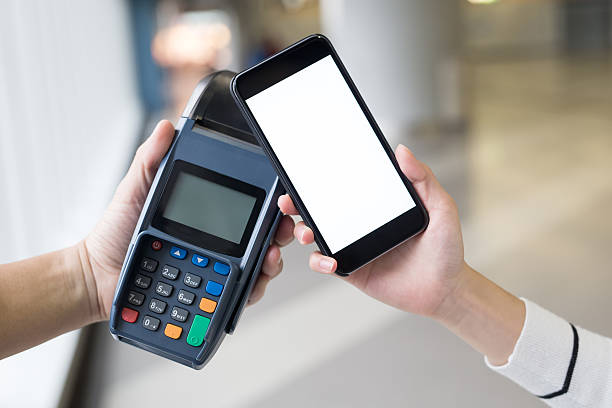 Paying with smartphone - foto de stock