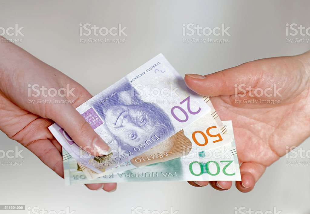 Paying with swedish currency, new layout 2015 stock photo