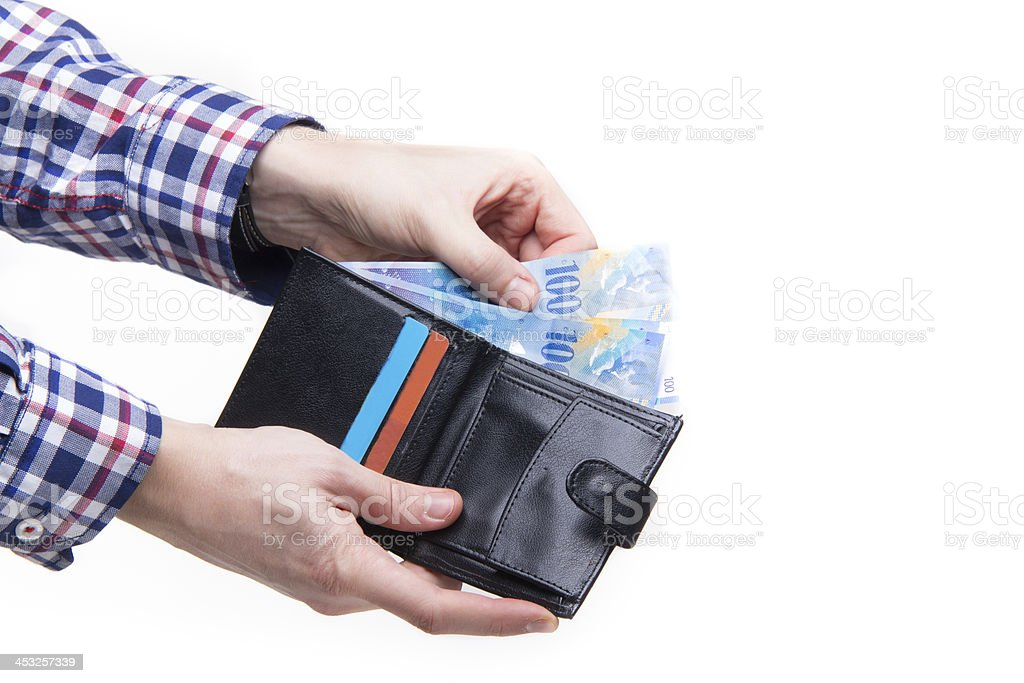 Paying with Swiss Francs stock photo