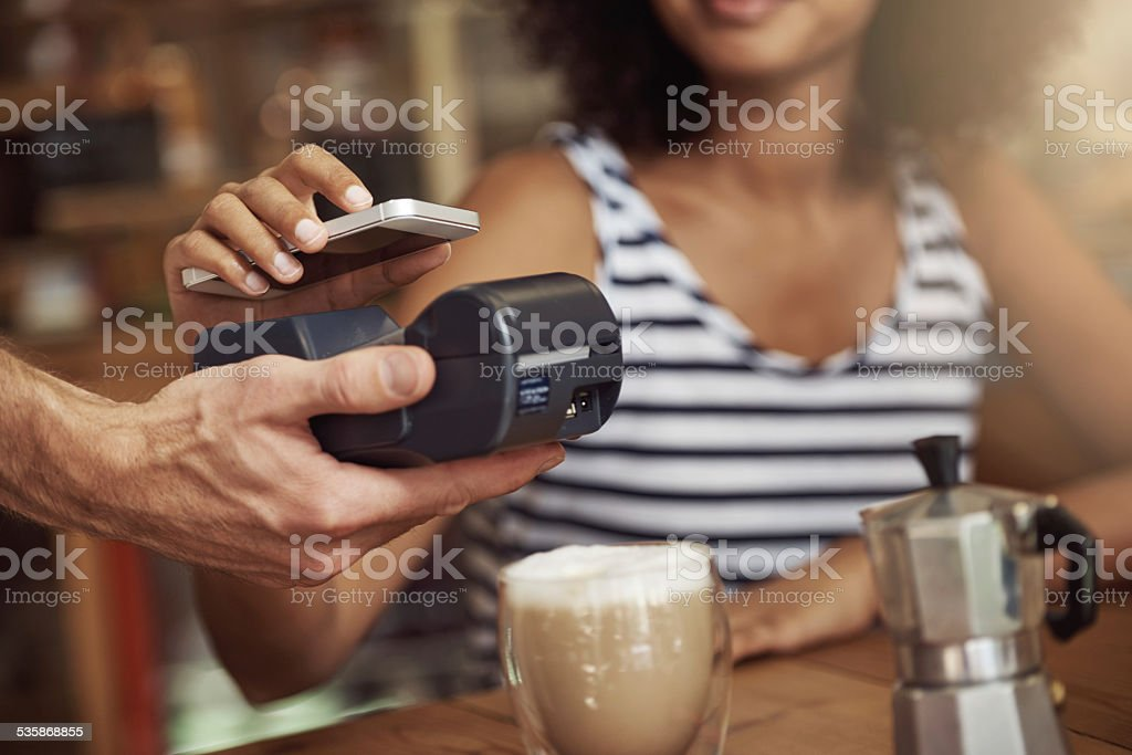 Paying without needing to reach for her wallet! stock photo