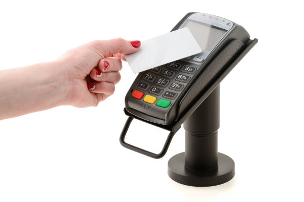 payment by contactless card through the pos terminal - paying with card contactless imagens e fotografias de stock