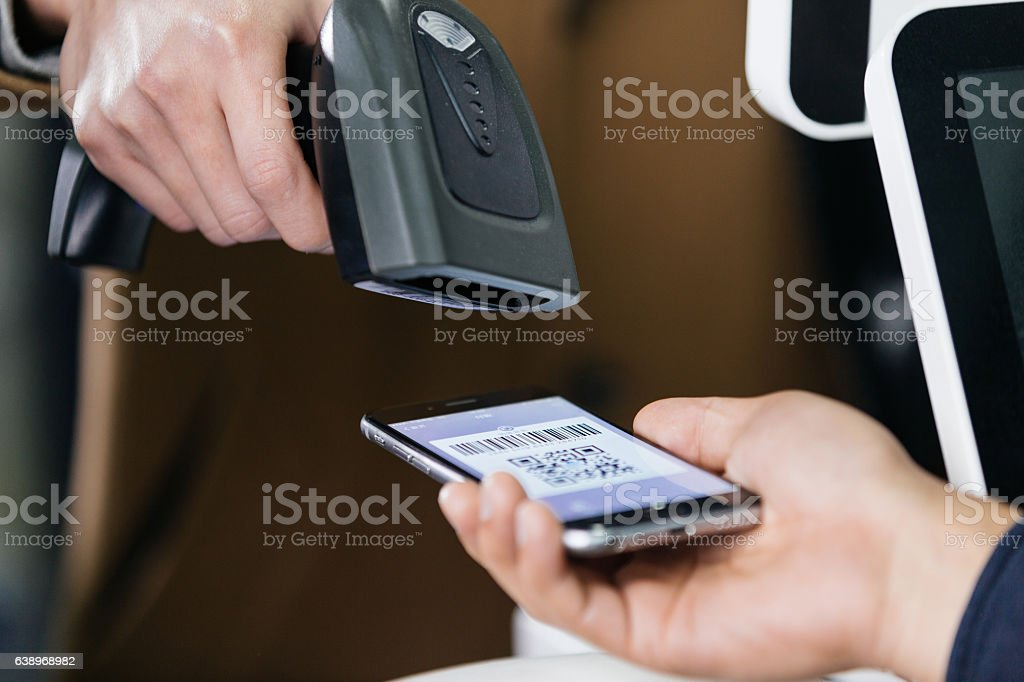 payment by mobile phone and checkout stock photo