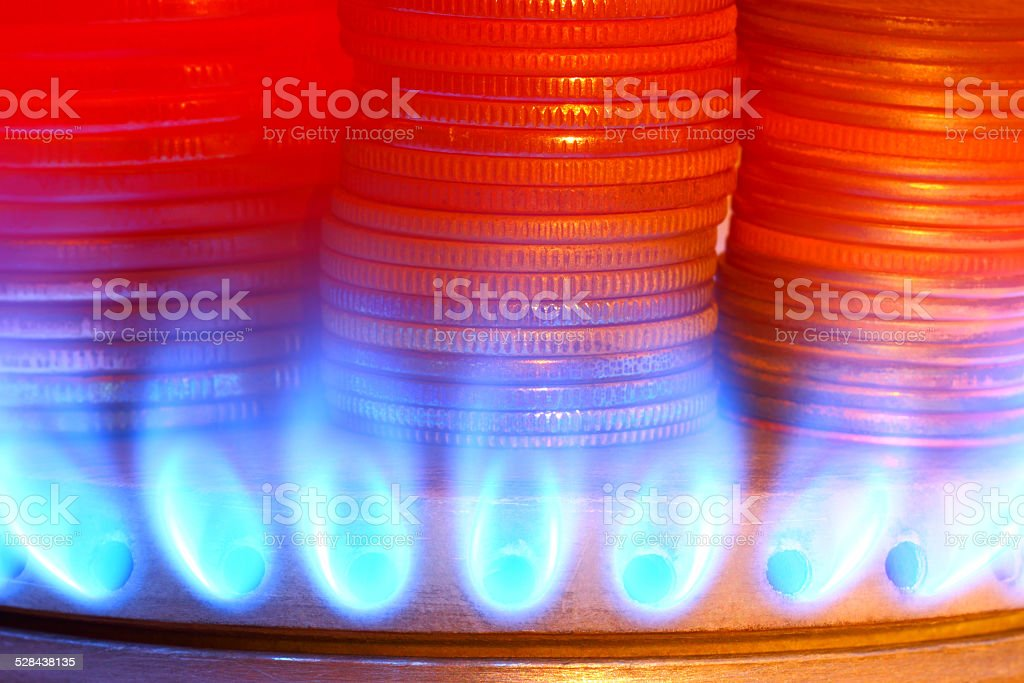 Payment for gas. Money and gas torch stock photo