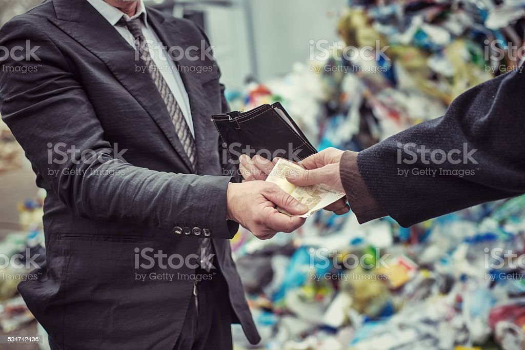 Payment in landfill stock photo