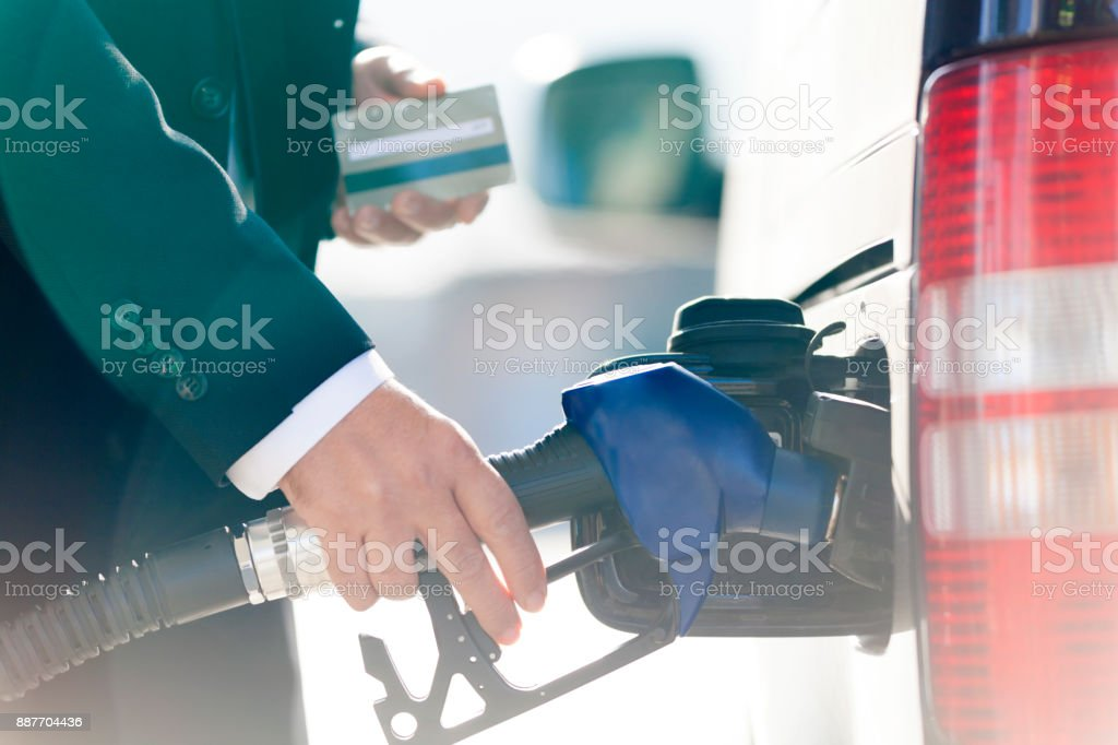 payment in the gas station stock photo