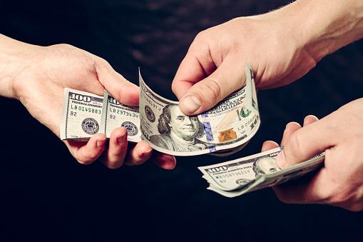 istock Payment of services, receiving bribes, exchange for information, Dollar bills. 1154818049
