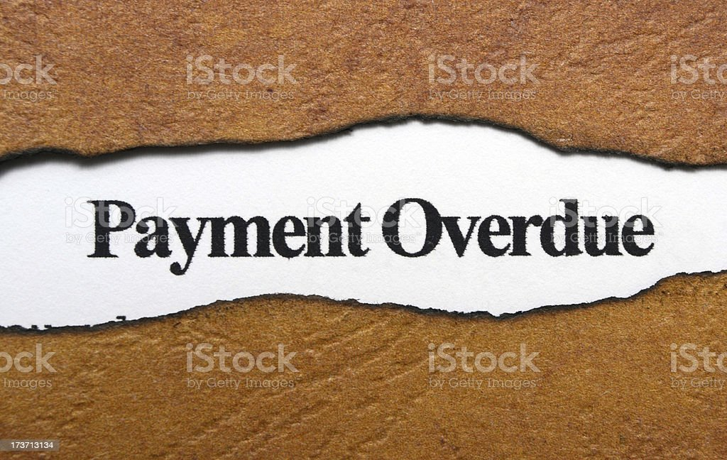 Payment overdue text on torn paper royalty-free stock photo