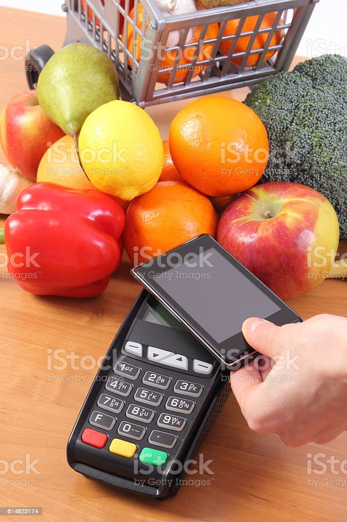Payment terminal and mobile phone with NFC technology stock photo