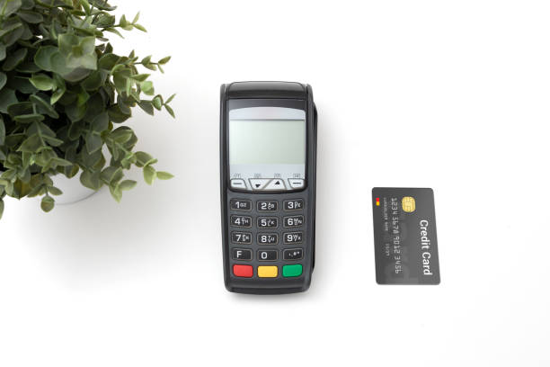 Payment terminal with credit card top view stock photo