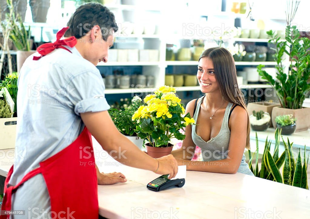 Payment with a Credit Card at The Florist stock photo