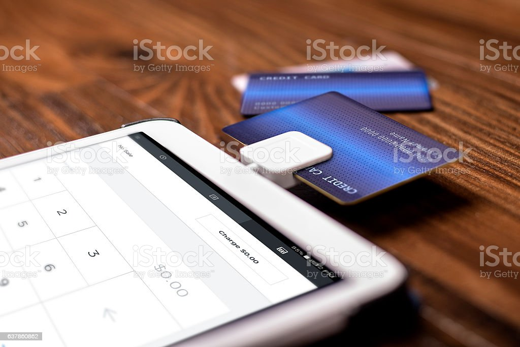Payment with a Credit Card Chip Reader on a Tablet stock photo