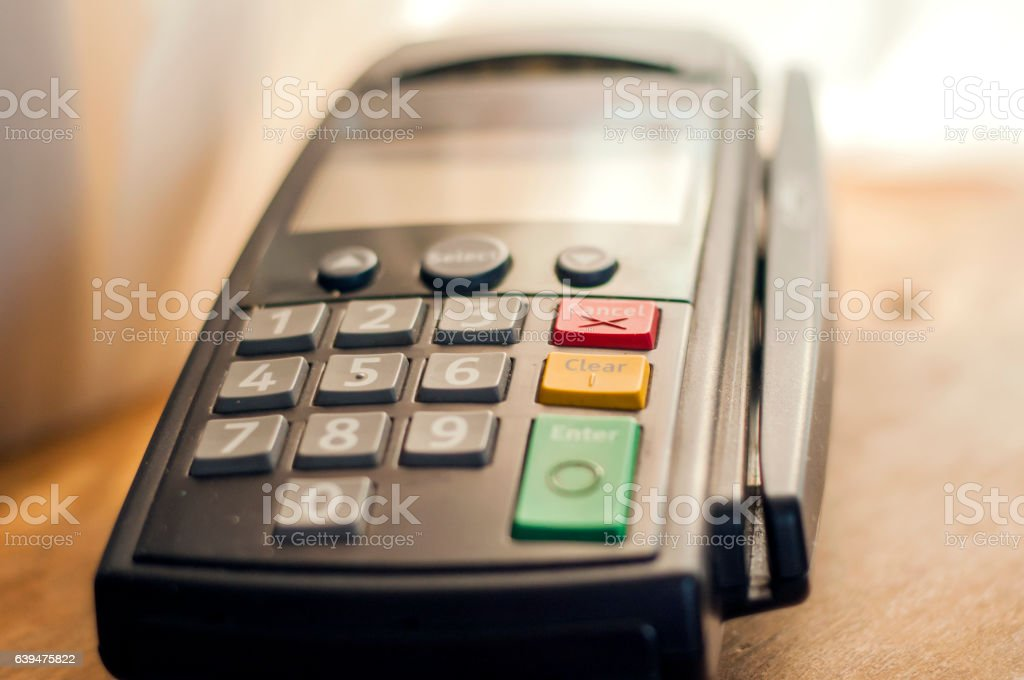 Payment with credit card - businessman holding pos terminal. stock photo