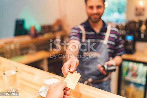 istock Payment with credit card in cafeteria 828735562